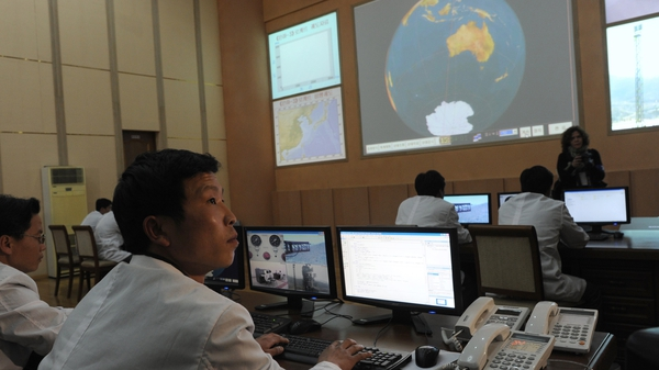 North Korean technicians working at the control room of the Tongchang-ri space centre