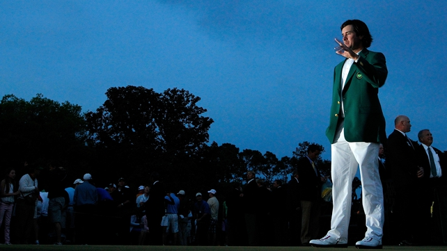 US Masters champion Bubba Watson salutes the crowd, donning the green jacket he earned at Augusta on Sunday
