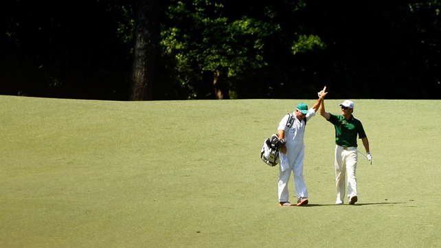 Louis Oostehuizen high fives after holing out from 235 yards on the second hole