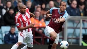Gabriel Agbonlahor of Aston Villa and Stoke's Wilson Palacios battle for possession in a match that failed to catch fire