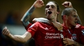 Carroll's injury-time goal wins it for Reds