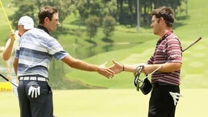 Charl Schwartzel (L) and Louis Oosthuizen on the ninth hole in Kuala Lumpur