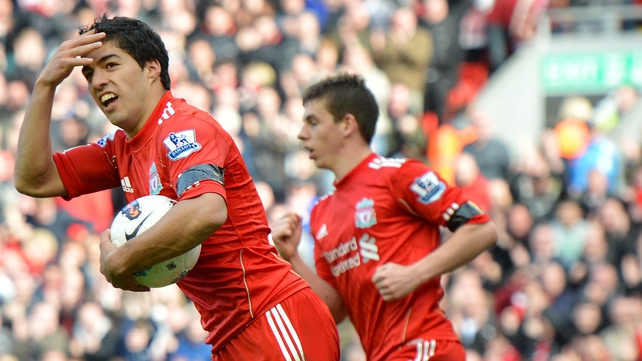 Luis Suarez has admitted he would he happy to handball a goalbound shot again if it will help Liverpool beat Everton