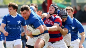 Robert Sweeney of St Mary's and Barry O'Mahony of Clontarf during the match