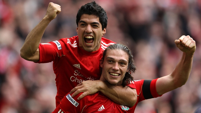 Luis Suarez, scorer of Liverpool's opener, celebrates with Andy Carroll, whose header earned his side a spot in the FA Cup final
