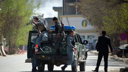 Afghan police head to the scene of an attack in Kabul