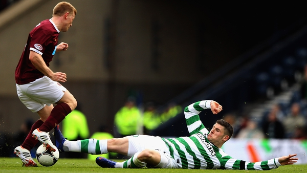 Garry Hooper of Celtic tackles Andy Driver of Hearts during their Scottish Cup semi-final clash