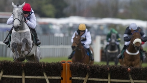 Super Duty (r) ran a huge race to finish second behind Simonsig (red cap) at Aintree. He'll now go chasing