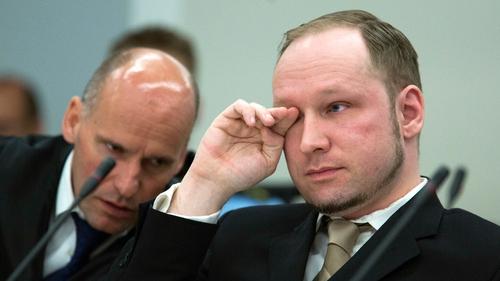 Anders Behring Breivik wipes away a tear as the court views his propaganda film