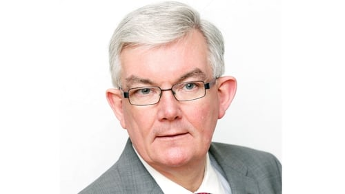 Ambrose McLoughlin will continue until a successor is appointed by the Government