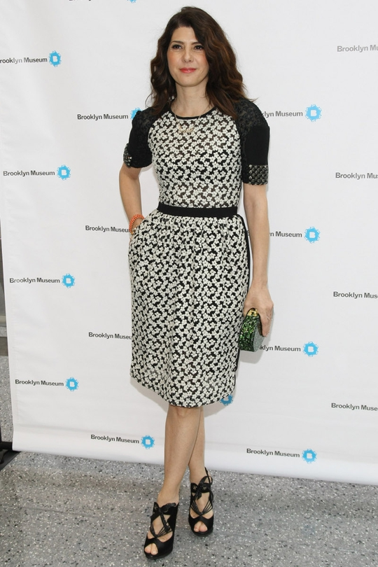 We love this monochrome print look on Marisa Tomei. With kinked out hair matched with possibly the best shoes of the week (by Nicholas Kirkwood) and a lovely glittered emerald Edie Parker clutch, this is brought together like a red carpet pro!