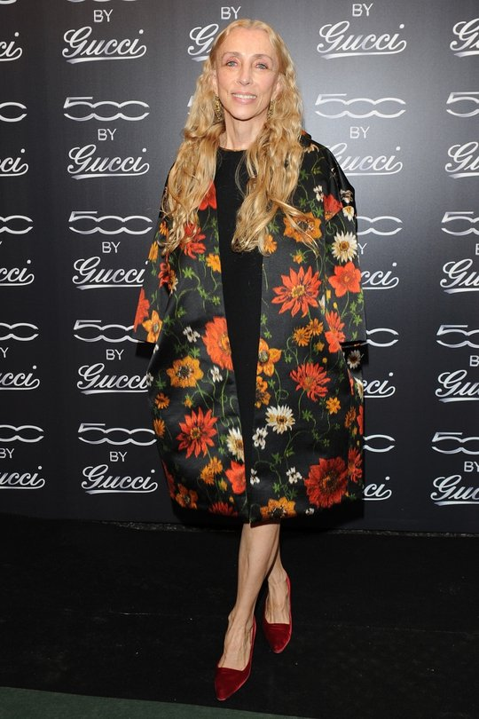 We love us a bit of Vogue Italia editor Franca Sozzani. Her look is always Romantic, yet updated. We love this bold floral statement coat and the velvet shoes are, again, a typical Franca touch.