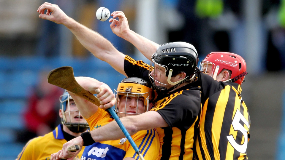 Not much room between Clare's John Conlon and the Kilkenny men  JJ Delaney and Tommy Walsh