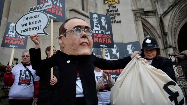 Protesters outside the Leveson Inquiry this morning