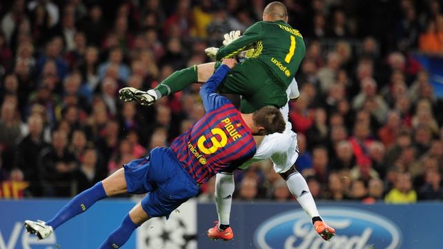 Gerard Pique was forced off after a nasty collision with Victor Valdes