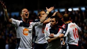 Bolton players celebrate David Ngog's strike at Villa Park