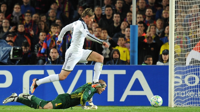 Chelsea striker Fernando Torres evades Barcelona keeper Victor Valdes as he earns his side a 2-2 draw at the Nou Camp