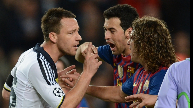 Chelsea captain John Terry argues with Sergio Busquets and Carlos Puyol after his sending off against Barcelona