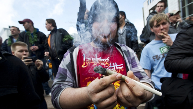 Protesters smoke marijuana during a demonstration against new government legislation calling for the creation of a 'cannabis card'