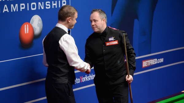 Stephen Hendry shakes hands with John Hendry after dishing out a 13-4  beating to his compatriot
