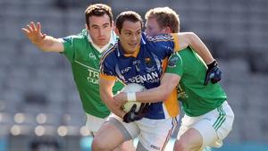 Wicklow's John McGrath breaks past Fermanagh duo Niall Bogue and Daryl Keenan