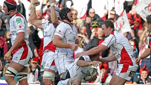 Ulster players celebrate teammate Pedrie Wannenburgs' try
