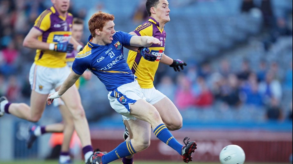 Longford's Paul Kelly Wexford gets to the ball just ahead of Wexford's Lee Chin