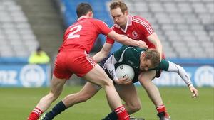 Aidan McCrory and Aidan Cassidy of Tyrone tackle Kildare's Alan Smith