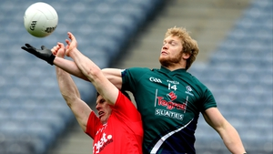 Tyrone's Conor Gormley and Tomas O'Connor of Kildare compete for the dropping ball