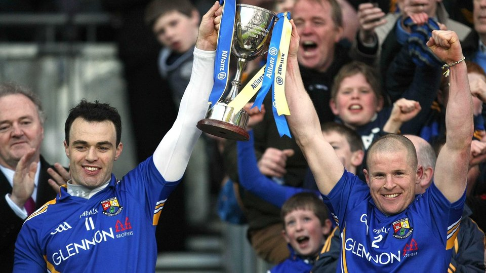 Longford captain Paul Barden and Dermot Brady (right) hoist the Division 3 cup after the win against Wexford