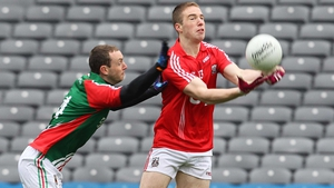 Colm O'Neill is tackled by Mayo's Keith Higgins