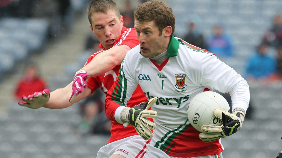 Mayo keeper David Clarke is put under pressure by Cork goalscorer Colm O'Neill
