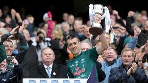 Kildare captain John Doyle lifts the Division 2 cup as GAA President Liam O'Neill and Taoiseach Enda Kenny look on