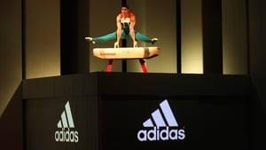 Adidas shares slump after full year profit outlook is cut