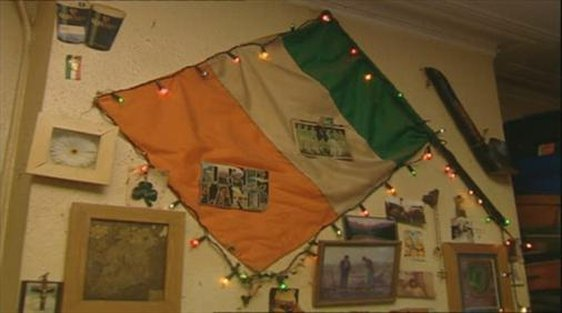 An Irish flag on the bedsit wall of an emigrant in London.