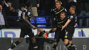 Spurs celebrate after Rafael van der Vaart restored their lead