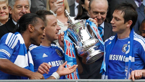 Didier Drogba, John Terry and Frank Lampard admire the FA Cup after Chelsea's fourth success in the competition in six years