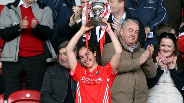 Cork captain Julia White lifts the Division 1 trophy after her side defeated Wexford by two points in the Semple Stadium decider