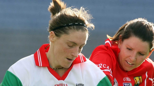 Longford manager Diane O'Hora (l) in her playing days with Mayo