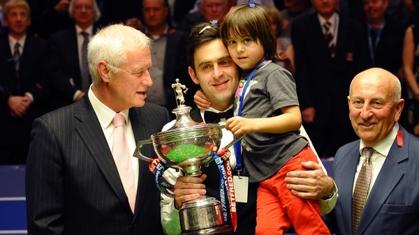 Ronnie O'Sullivan and his son celebrate his fourth world title