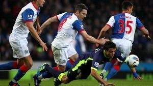 Wigan's Franco Di Santo takes a tumble under pressure from David Dunn