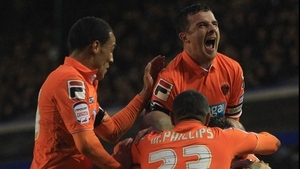 Blackpool players mob Stephen Dobie after his crucial opener