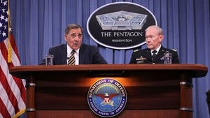General Martin Dempsey (R) at a press conference with Defence Secretary Leon Panetta