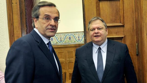 Leader of the New Democracy conservatives Antonis Samaras (L) meets socialist party leader Evangelos Venizelos at the Greek Parliament