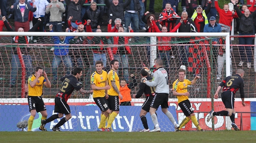 Crusaders' Colin Coates (6) turns to celebrate scoring his side's second goal