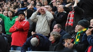Manchester United fans are dejected as the news of Aguero's goal starts to filter through