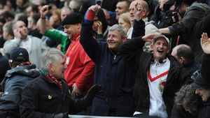 Manchester United supporters celebrate after hearing that QPR had taken the lead against Manchester City