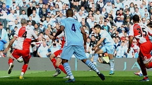 Serigo Aguero scores for Manchester City deep in injury time, claiming the goal that won the title