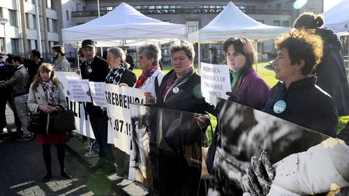 Widows of the Srebrenica victims protested outside the court
