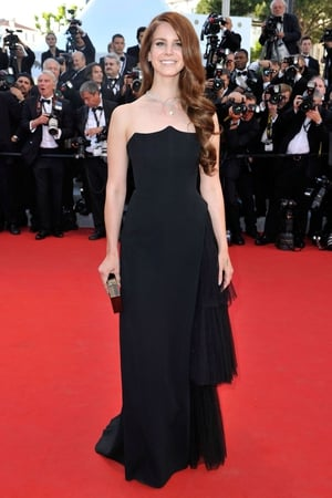 Lana Del Rey looks radiant in this black, strapless Alberta Ferreti dress. LDR always has the most envious locks which are unrivalled on the red carpet. The sheen, the loose curl, it's all about the hair most of the time but this dress really took centre